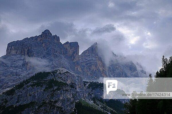 Lavarella and Conturines in clouds  near Capanna Alpina  Fanes Sennes Braies nature Park  Val Badia  Abbey  Ladinia  Dolomites  South Tyrol  Italy  Europe