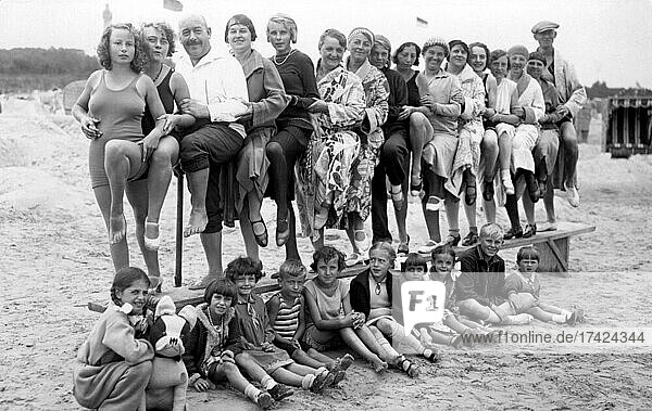 Group with bathers on the beach  funny  laughing  summer holidays  holiday  joie de vivre  Baltic Sea  about 1930s  Binz  Rügen  Mecklenburg-Western Pomerania  Germany  Europe