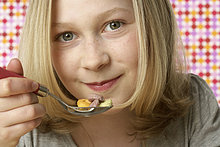 Girl eating cornflakes
