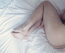 Herren Beinen auf einem Bett, Montreal, Quebec
