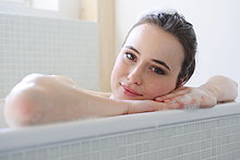 Young woman enjoying bath