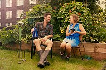 Couple taking a break on council estate allotment