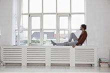 sitzend ,Mann ,Fenster